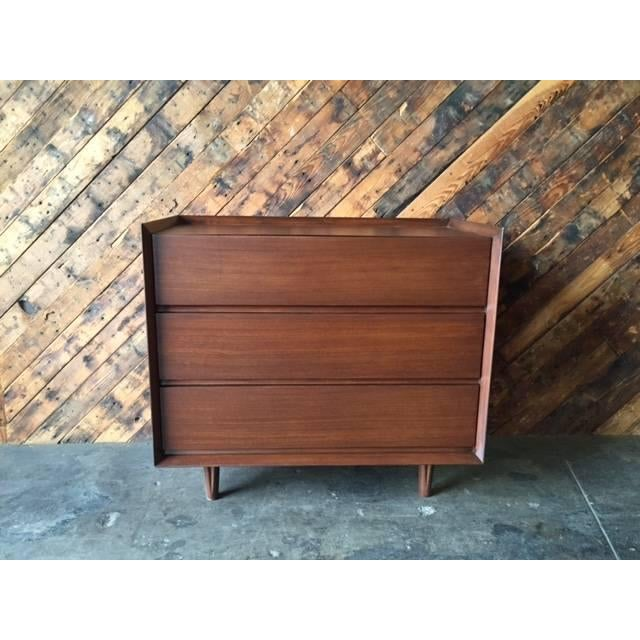 This is a newly refinished walnut wood dresser. It features three deep drawers and an angled top. A matching long dresser...