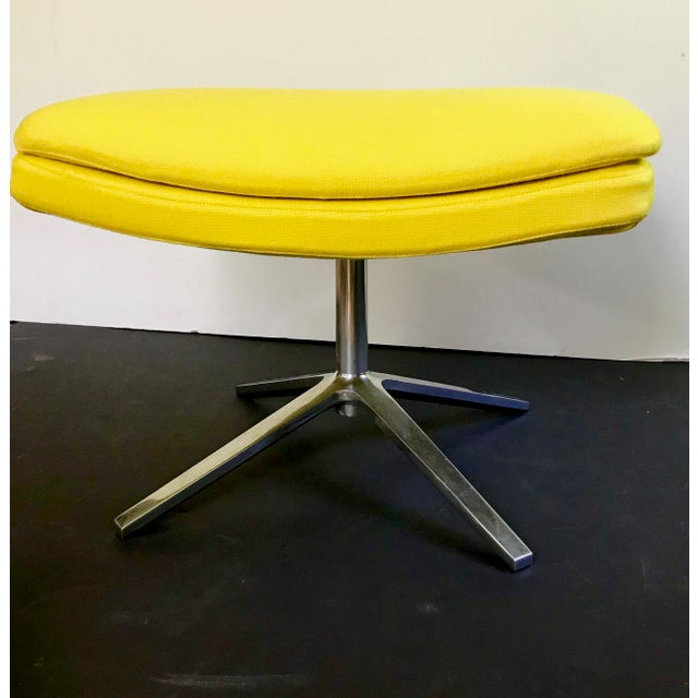 A bright yellow upholstered ottoman for the Metropolitan armchair designed by Jeffrey Bernett in 2003, and made in Italy....