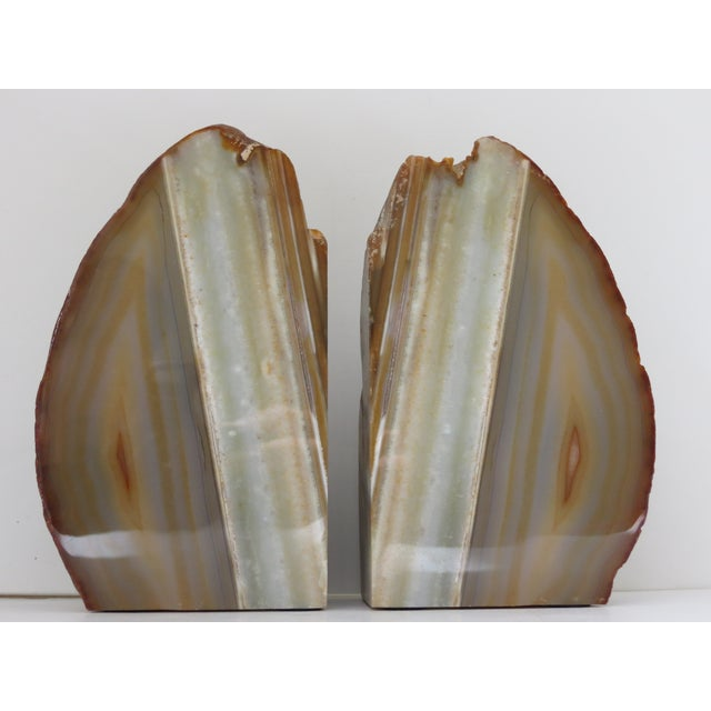 Wonderfully detailed pair of natural stone bookends with polished faces. Exquisite veining! In excellent shape.