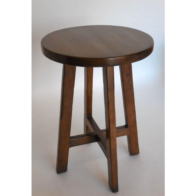 Petite round walnut table with criss cross stretchers. Can be made in any size and finish. Made in Los Angeles by Dos...
