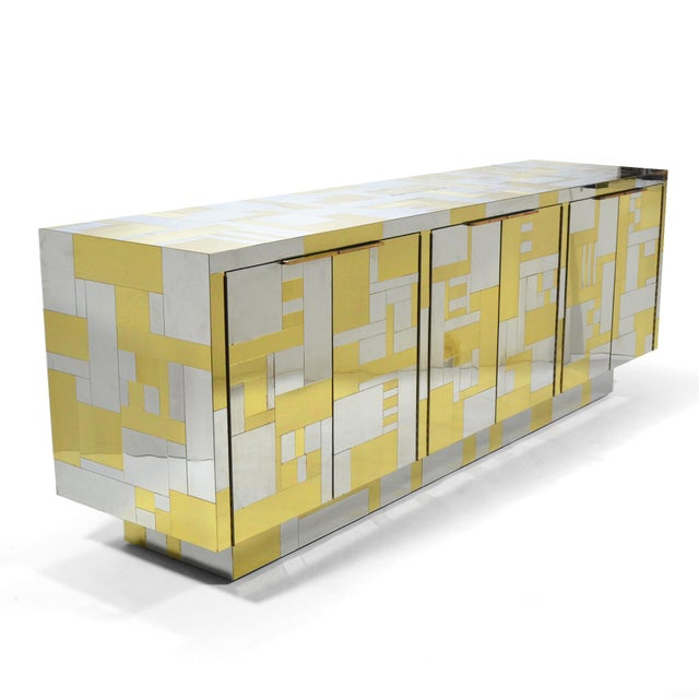 This stunning credenza is from Evans' PE200 Cityscape series and has the most pleasing composition of brass and chrome...