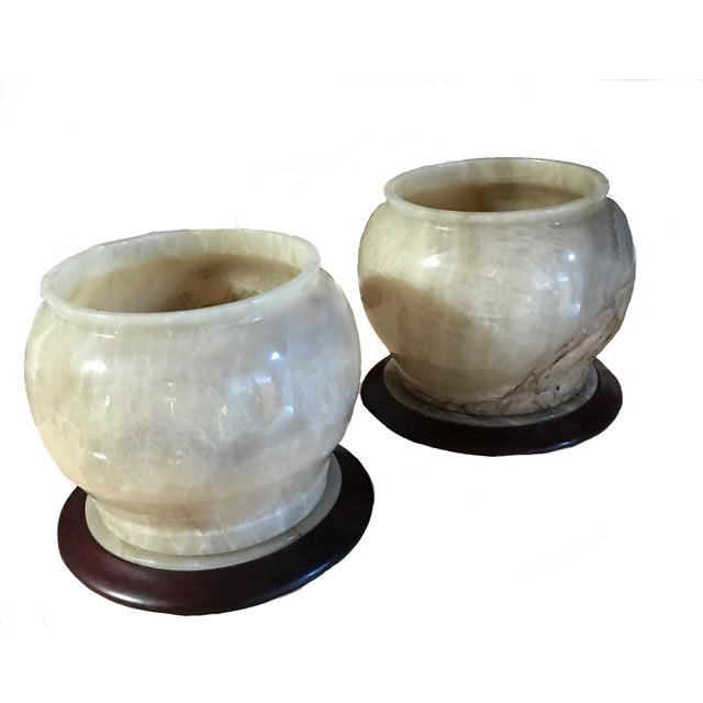 A beautiful pair of pure alabaster bowls which can be placed on top of their matching alabaster and mahogany wood bases or...