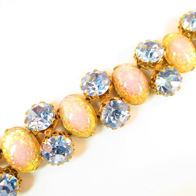Offered here is a Schiaparelli demi-parure of gold-plated bracelet and clip-back earrings from the 1950s. The segmented...