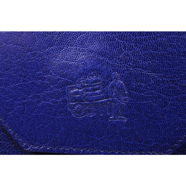 La Bagagerie is known for chic and stylish bags Made in France. This bright electric blue envelope clutch is a great...