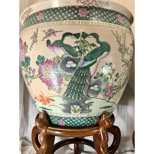 Large pair of Chinese famille verte porcelain jardinieres / planters / fish pots with stand each featuring six hand...