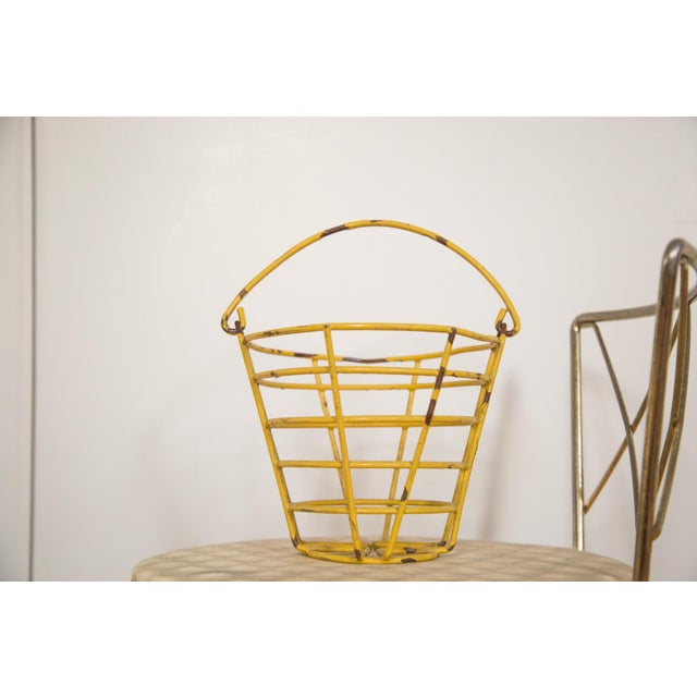 Vintage industrial / farmhouse chic small egg basket that features a mustard yellow color atop metal. Perfect for small...