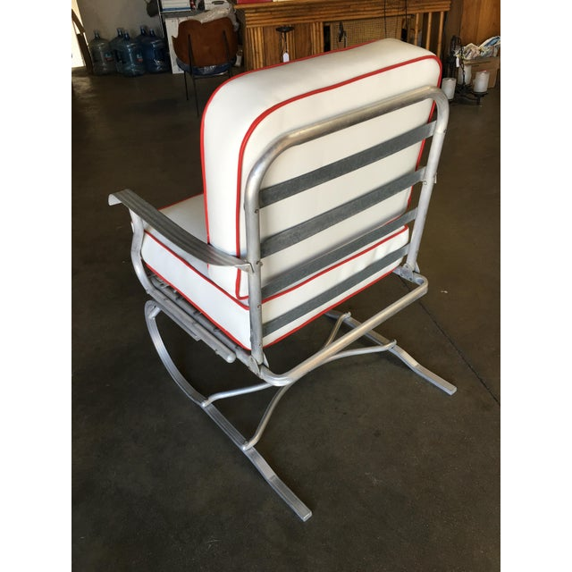 Mid-century springer rocking consisting of an aluminum frame with a large sled shaped steel spring legs which let the...