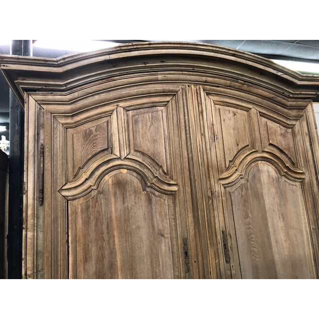 French Louis XIV oak armoire from the late 18th/ early 19th c. done in a beautiful stripped finish. Consisting of an...