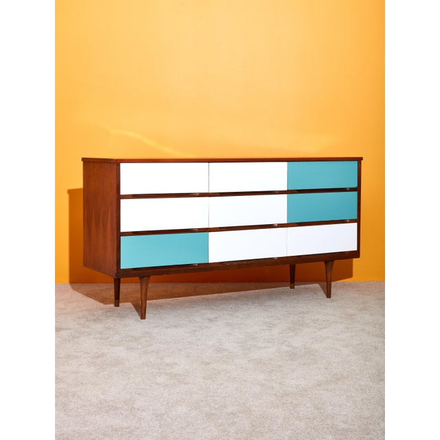 Vintage circa 1960s Danish walnut dresser with 9 drawers. Features newly laminated drawer fronts in white and blue. Great...