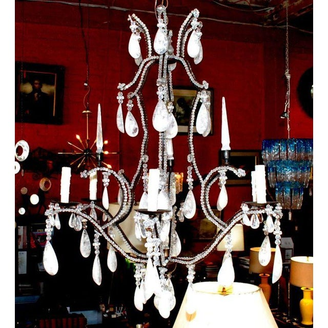 Six-light black iron frame rock crystal chandelier.