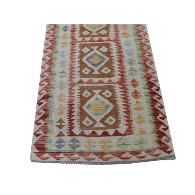 One of a kind vintage Afghani vegetable dye handmade kilim runner. All wool and vegetable dyes. This is a hand-made piece...