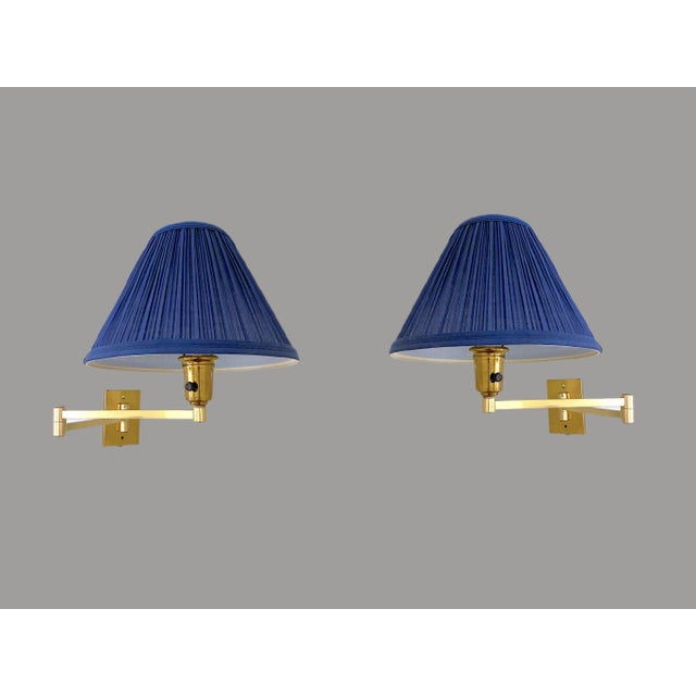 A classic of industrial design, these vintage double swing arm lamps are considered the finest expression of the swing arm...