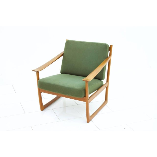 Rare lounge chair FD 130 by Peter Hvidt & Orla Molgaard, by France & Son, Denmark. Solid teak wood and fabric. Designed in...