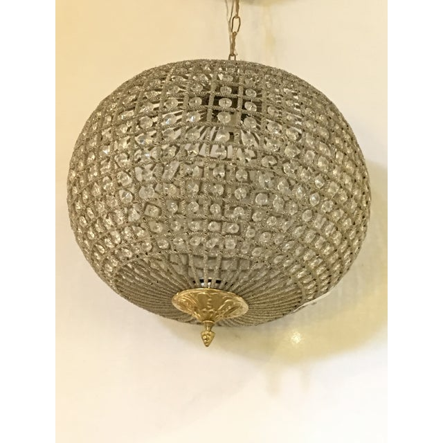 Exquisite globe pendant chandeliers, each in circular shape and wired with crystals. Complete with ten inch chain and...