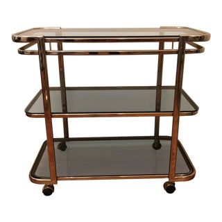 1970's Hollywood Regency Brass & Smoked Glass Bar Cart For Sale