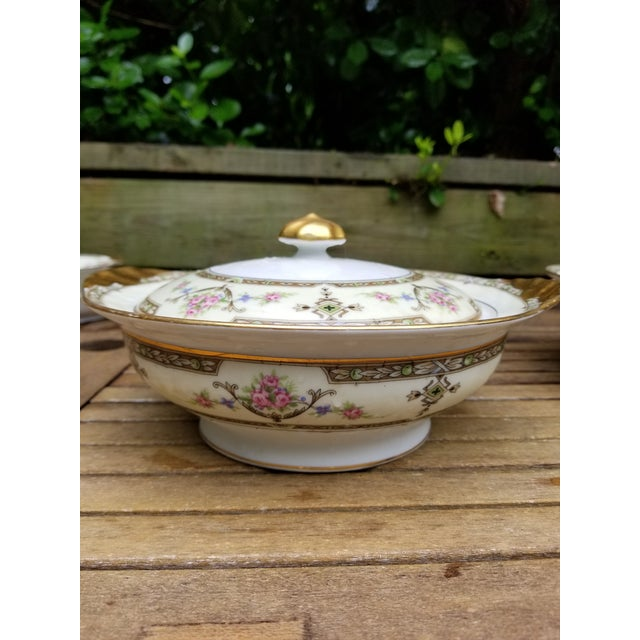 This serving bowl with lid is a great size. There are two available, but one has a little chip on an edge. This is an...