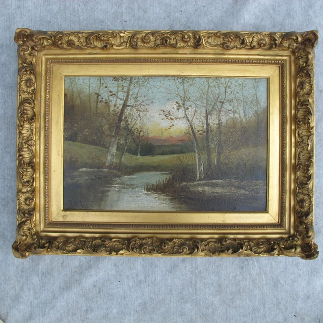 Wonderful painting of autumn scene with river in gold leaf frame. Excellent condition with No repairs. Dated 1904 With...