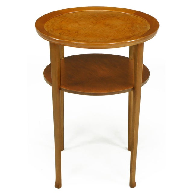 Restored side table constructed of solid maple and maple veneer with inlaid buffalo hide top. Similar in design to an...