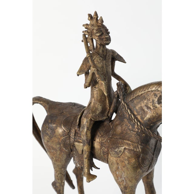 Wonderful decorative and heavy cast brass of an African horse rider. The horse and warrior are in the style of the Dogon...