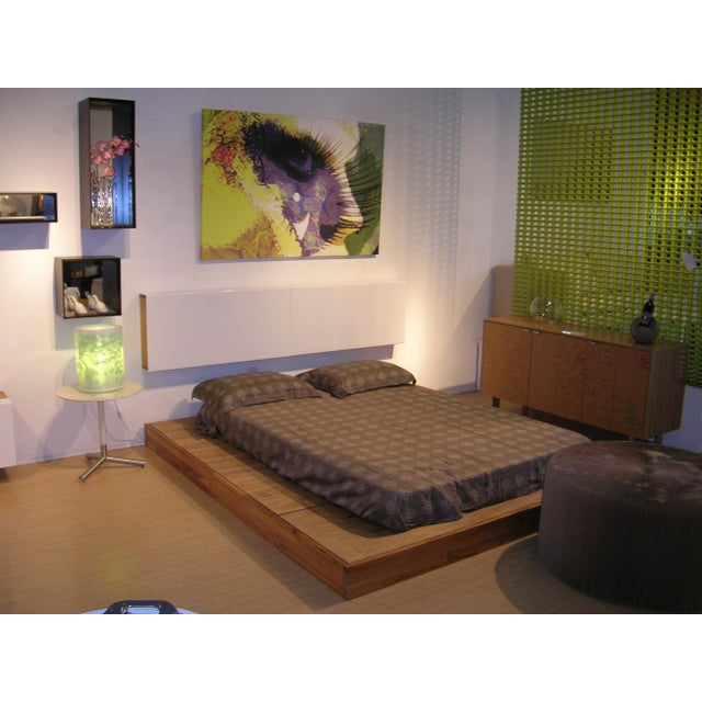 Designer: Bernard Brucha The LAX storage platform bed and a sleek wall mounted headboard with white sliding doors for...