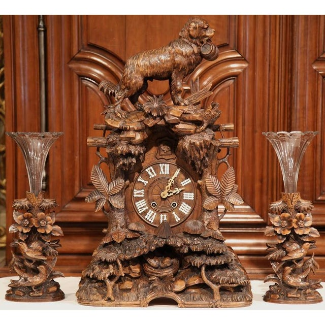 This monumental three-piece carved walnut cuckoo clock set was carved in Switzerland, circa 1870, making it perfect for a...