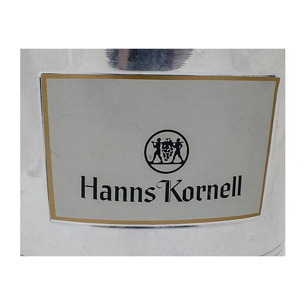 """Vintage French champagne ice chiller bucket. Front label reads """"Hanns Kornell"""" with the vintner's logo of two men carrying..."""