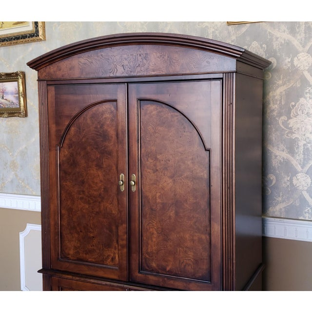 Fantastic Hekman Furniture entertainment TV armoire. Made from burl walnut and solid wood. Having an arched top with 2...