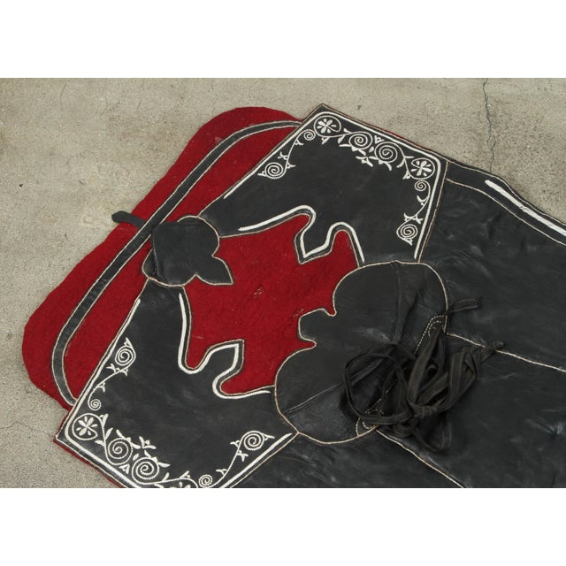 Handcrafted Moroccan horse Saddle pad or blanket, made of black leather, made for a ceremonial Festival and shows. The...