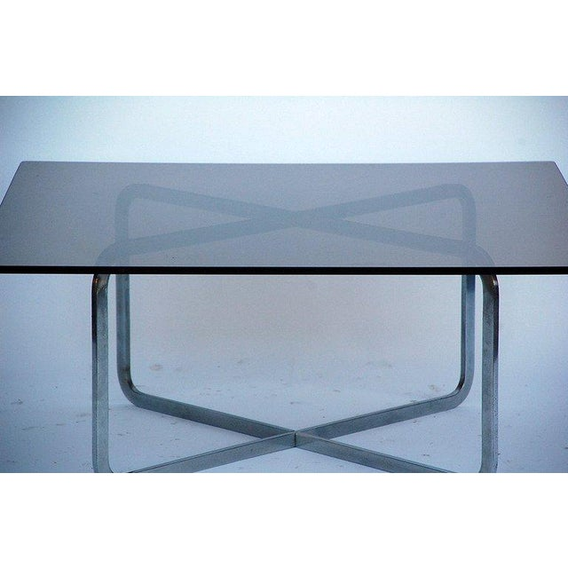 Minimalistic brushed steel and smoked glass coffee table in the style of Michel Boyer
