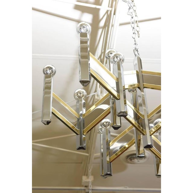 This mixed metals of brass and nickel silver of this Gaetano Sciolari for Lightolier has been professionally polished and...