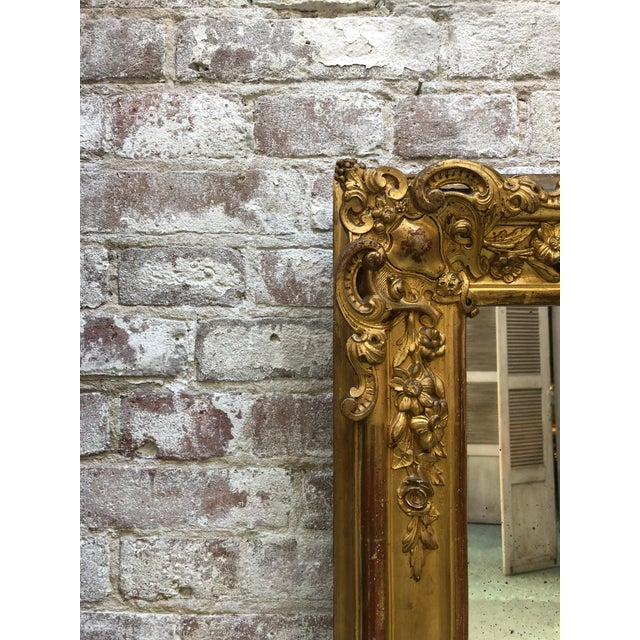 19th century mirror, gold leaf gilded with its original mirror-glass, Provenance France This rectangular mirror is adorned...