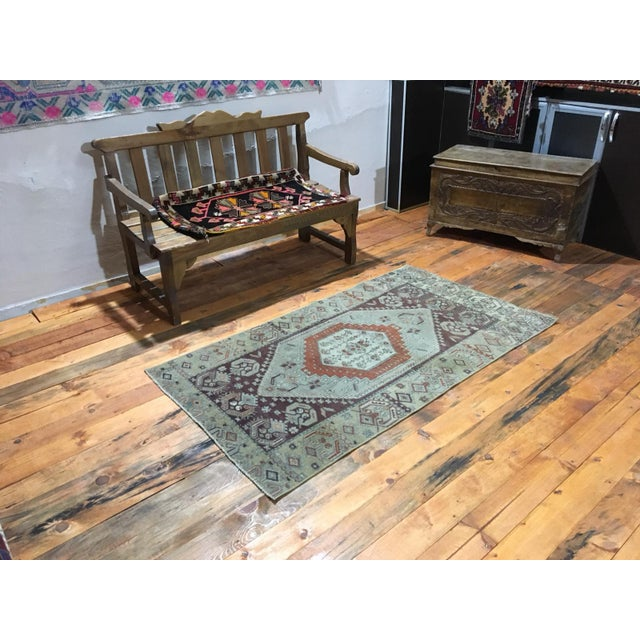 This is a vintage Anatolian Oushak rug from the 1980s. The piece was vegetable dyed, and it was professionally cleaned and...
