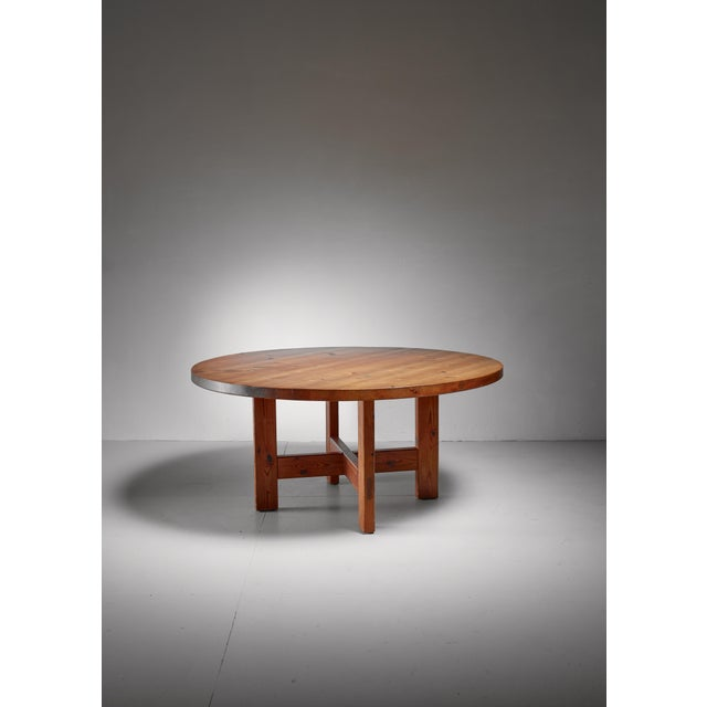 A Roland Wilhelmsson model 'RW 152' solid pine dining table for Karl Andersson & Söner, Sweden. This rustic table has a...