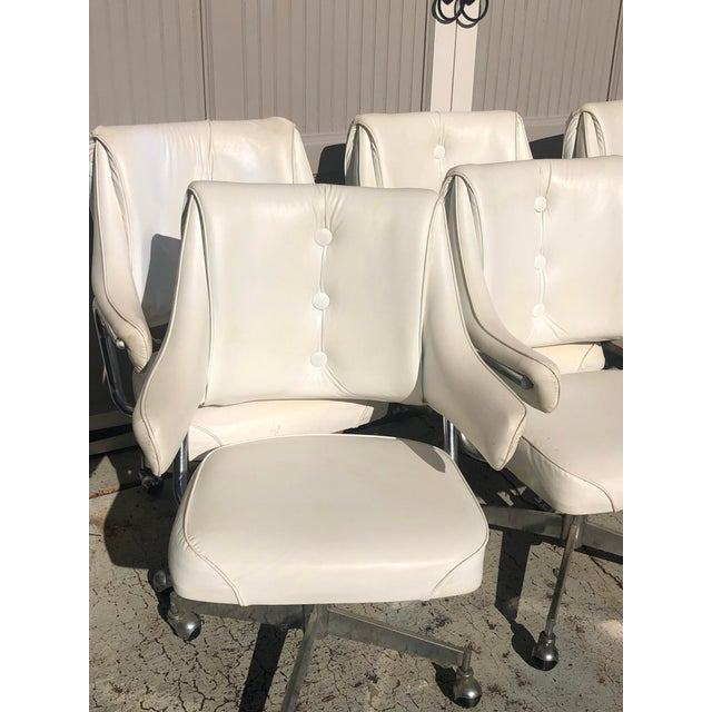 Super fun and sleek MCM set of six vinyl and chrome swivel armchairs on casters. Perfect as a dinette set or for use in an...