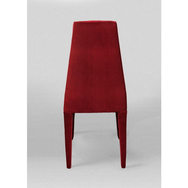 Stunning set of 8 dining chairs reupholstered in a hardy cotton Chinese Red velvet. Unique tapered, full upholstered legs.