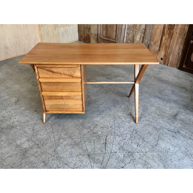 Solid Maple crossed leg desk with book cubby on the back side.
