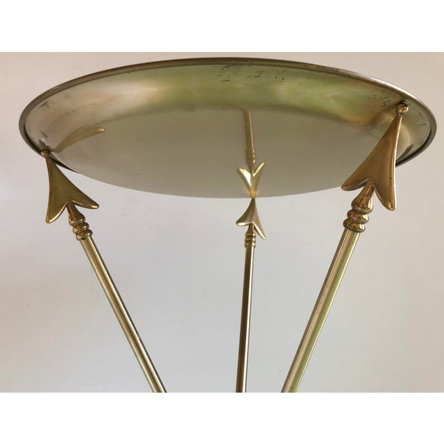 This is a 1960s vintage Maison Jansen Hollywood Regency tray table. The piece features brass arrows and a brass tray that...
