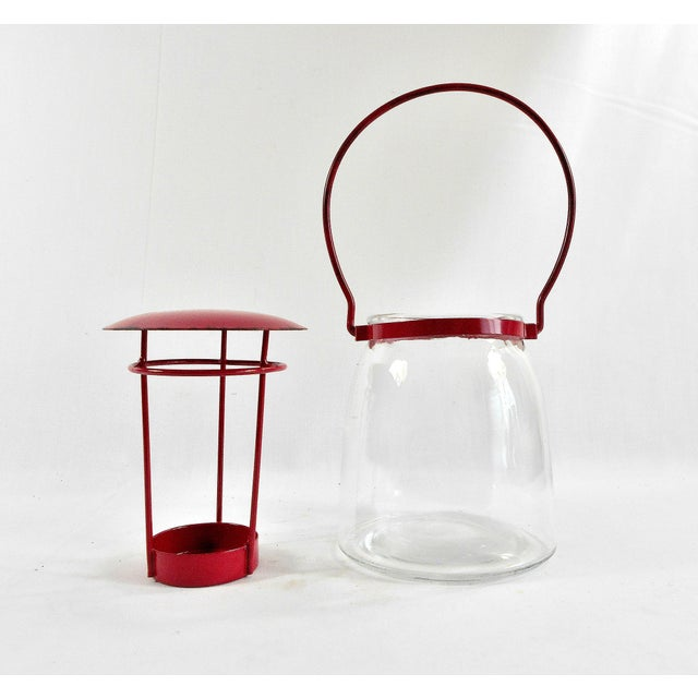 This adorable round glass/red metal candle lantern will bring the fun into your party. It is made from metal and clear...