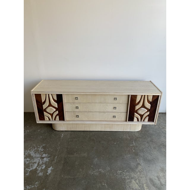 Made in Canada in the 1970's with a true brutalist design. Sideboard features two doors with a shelf inside and three...