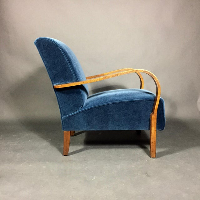 Simplicity of design with maximum style results. This late 1930s Danish chair with an oak frame has classically curved...