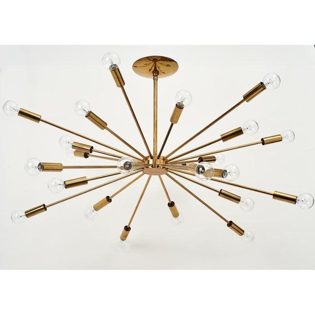 'Astral Skyrocket', an exceptionally fine vintage Sputnik chandelier with 24 slender tubular brass arms joined at a puck...