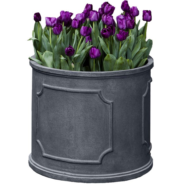 A round planter of Fiber Clay Composite in a lead lite finish. Available in multiple sizes or as a set of five. This...