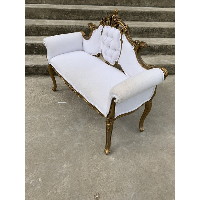 Darling little settee. Perfect for a foyer or master bath. Carved wood with gold leaf or paint finish. White damask fabric...
