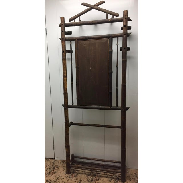 Wonderful faux bamboo mirrored coat rack (Hall Tree) from France. Lots of hanging space with three large hooks across the...
