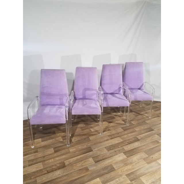 This set of four modern, cheerful purple chairs are delightfully unique and stylish. The singular transparent Lucite tubes...