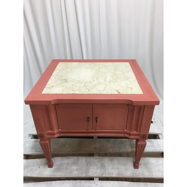 A beautiful marble top end table with cabinet doors. This table has been painted with Annie Sloan chalk paint in...