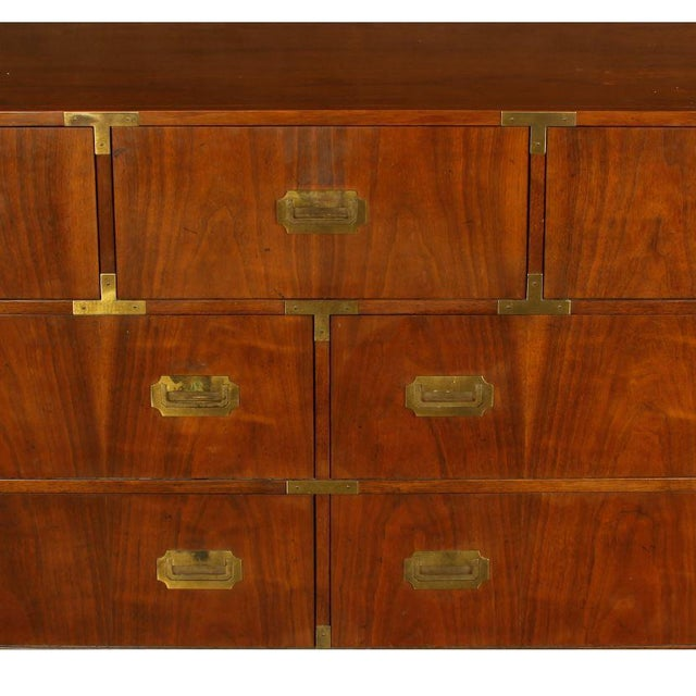 Baker mahogany Campaign style chest of drawers with handsome hardware details. Three drawers on top with four drawers below.