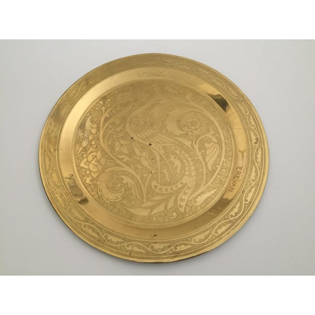 This vintage Mid Century Armenian solid brass hand etched peacock round serving tea tray is a very special and beautiful...