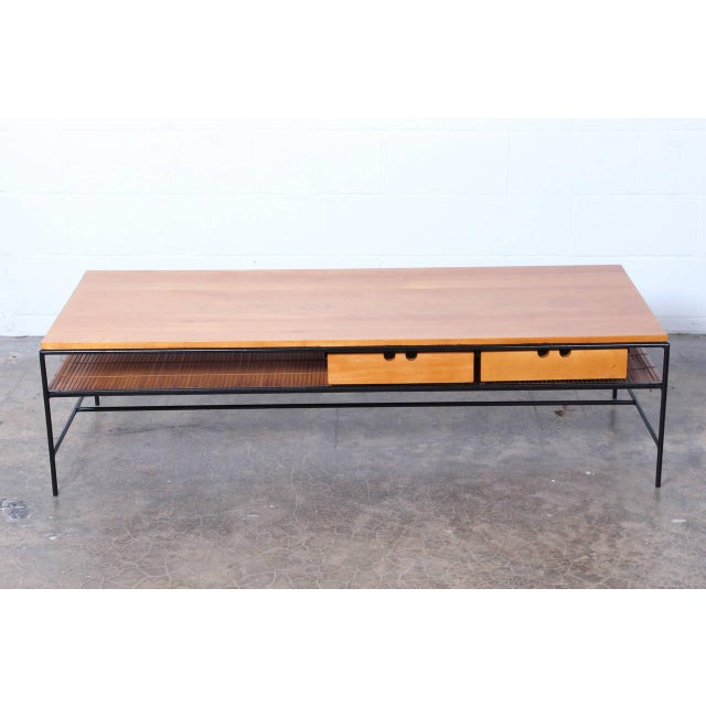 A maple and iron coffee table designed by Paul McCobb for Winchendon.