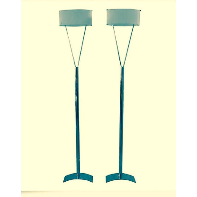 This pair of beautiful Italian floor lamps are created by Leucos in the 1970's. The model Vittoria has a modern flair...